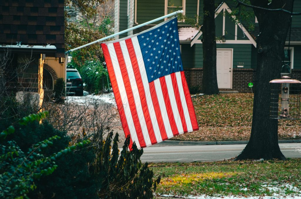 American flag on a house, qualifying for a VA home loan