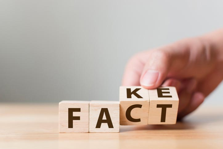 "Four letter blocks being changed from the word ""FAKE"" to ""FACT"""